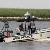 DNR Police boat with a boat in tow heading for Delaware City..