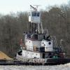 Past the Woodland Ferry heading downriver with a load of sand.